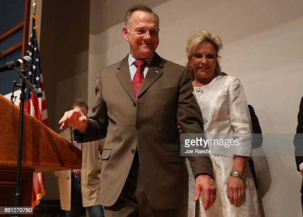 Republican Senatorial candidate Roy Moore walks with his wife Kayla Moore after saying the race against his Democratic opponent Doug Jones is too...