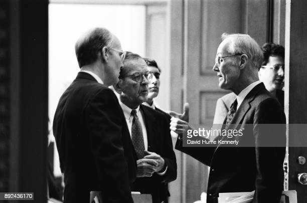 Republican senators Larry Craig of Idaho Ted Stevens of Alaska and Slate Gorton of Washington confers during the Senate Impeachment Trial of...