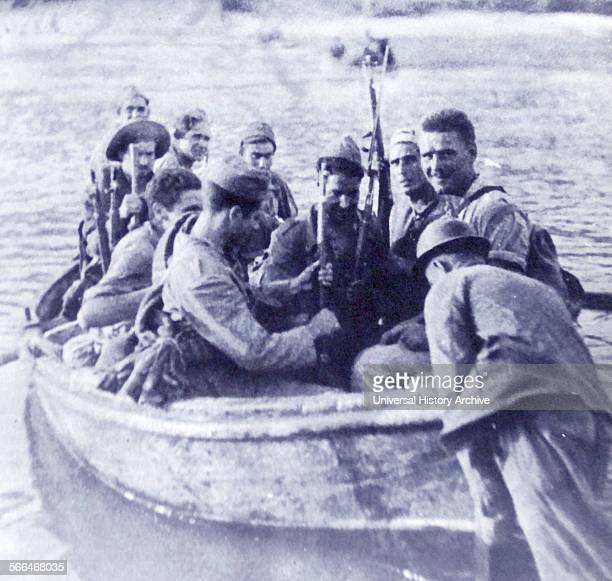 Republican soldiers cross the Erbo River during the Battle of the Ebro the longest and largest battle of the Spanish Civil War It took place between...