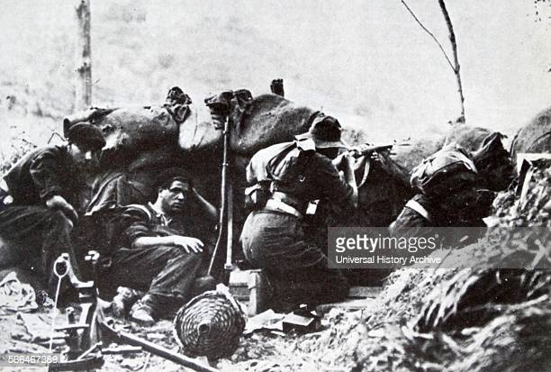 Republican soldiers shelter in a trench during the Campaign of Gipuzkoa, the Spanish Civil War, Nationalist Army conquered the northern province of...