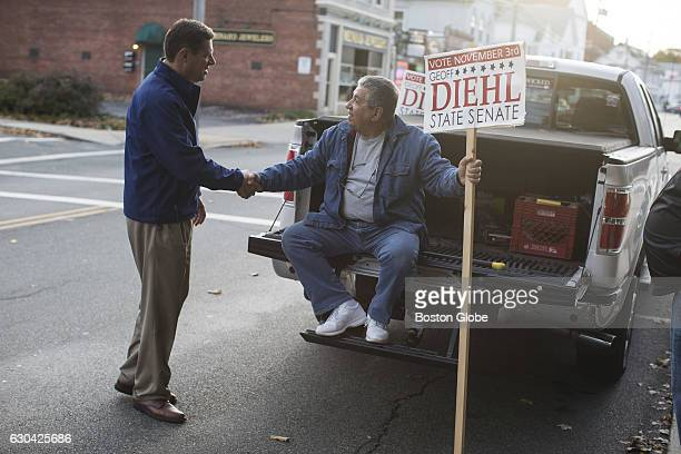 Republican State Representative Geoff Diehl greets supporter Jack Lenoci right before a campaign stop with Massachusetts Governor Charlie Baker in...