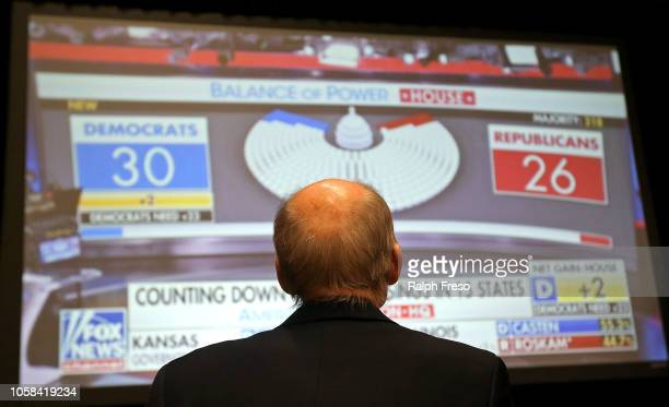 Republican suporter watches midterm election returns on a big screen monitor during an election night event for Arizona GOP candidates on November 6...