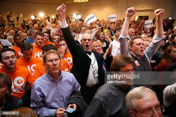 Republican supporters including John Eads of Colorado Springs Colorado cheer as a television broadcast declares the Republicans had taken control of...