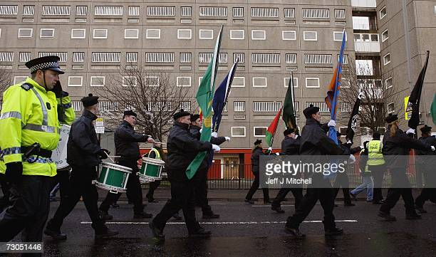 Republican supporters parade in remembrance of the victims of Bloody Sunday January 20 2007 in Glasgow Scotland A heavy police presence kept rival...