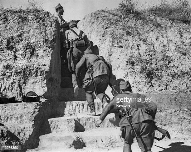 Republican troops of the International Brigades moving into a communications trench at Navalcarnero near Madrid at the beginning of the Nationalist...