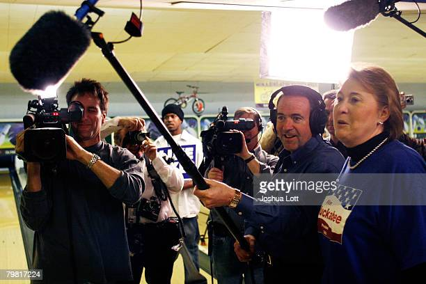 Republican U.S. Presidential hopeful and former Arkansas Gov. Mike Huckabee wears an audio headset during a bowling game against the media at Olympic...