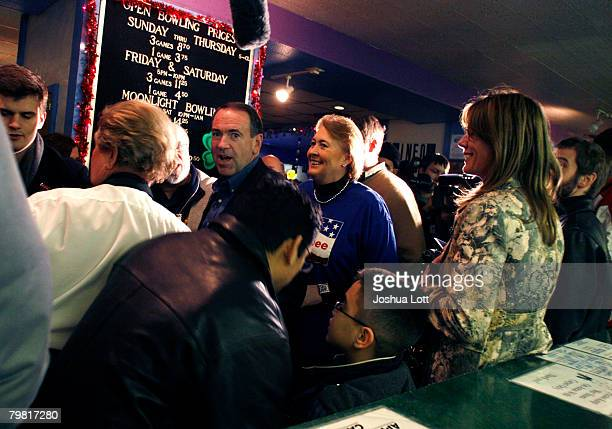 Republican U.S. Presidential hopeful and former Arkansas Gov. Mike Huckabee and his wife Janet greet supporters during a campaign stop at Olympic...