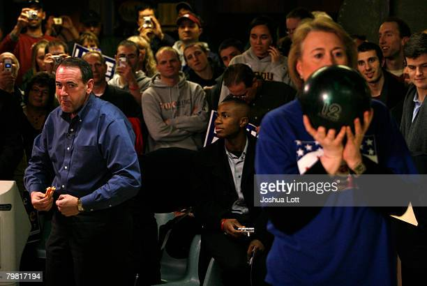 Republican U.S. Presidential hopeful and former Arkansas Gov. Mike Huckabee jokes as he watches his wife Janet as she bowls during a game against the...