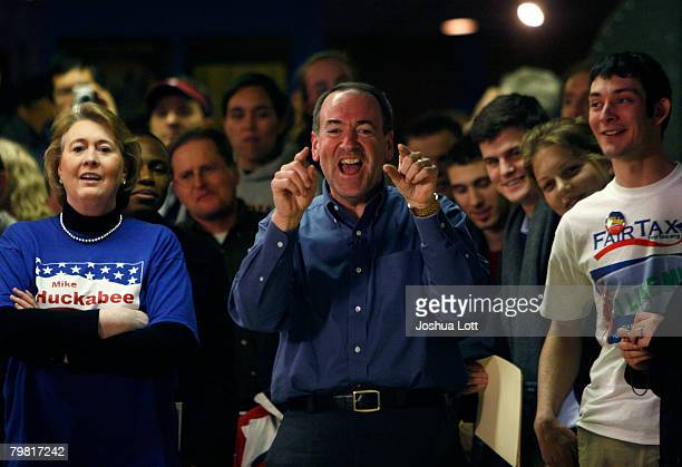 Republican U.S. Presidential hopeful and former Arkansas Gov. Mike Huckabee laughs at a member of the media as he bowls with his wife Janet at...