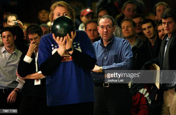 Republican U.S. Presidential hopeful and former Arkansas Gov. Mike Huckabee watches his wife Janet as she bowls during a game against the media at...