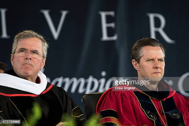 Republican US presidential hopeful and former Florida governor Jeb Bush and Liberty University president Rev Jerry Falwell Jr sit next to each other...