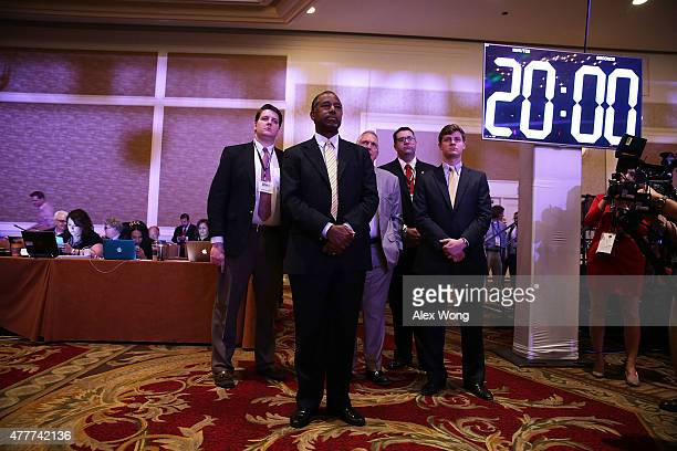 Republican US presidential hopeful Ben Carson waits to be introduced during the 'Road to Majority' conference June 19 2015 in Washington DC...