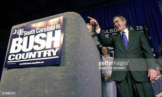 Republican US presidential hopeful George Bush points supporters upon his arrival at the Columbia Metro Airport 07 January 2000 in Columbia South...