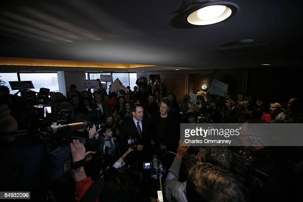 Republican US Presidential hopeful Gov Mike Huckabee and his wife Janet Huckabee attend a early morning fundraiser hosted by supporters on December 7...