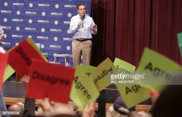 Republican US Representative Darrell Issa speaks at a town hall meeting at a high school in San Juan Capistrano California June 3 2017 / AFP PHOTO /...