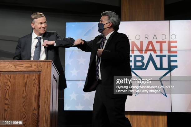 Republican U.S. Sen. Cory Gardner, right, and Democratic former Colorado Gov. John Hickenlooper elbow bump after the first live televised U.S. Senate...