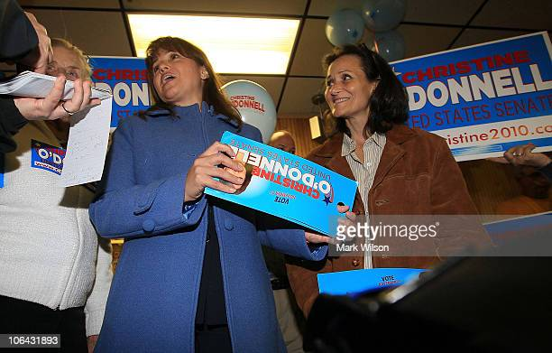 Republican US Senate candidate Christine O'Donnell talks to a reporter while greeting people during a campaign stop at the First State Bowling Center...