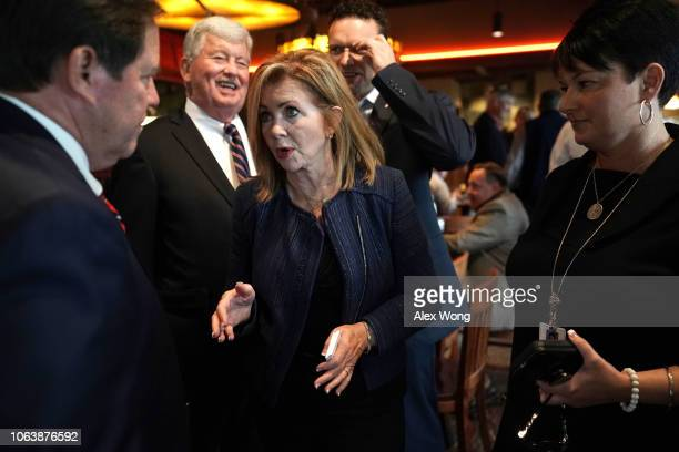Republican US Senate candidate for Tennessee Rep Marsha Blackburn talks to Knox County Sheriff Tom Spangler during a campaign stop November 5 2018...
