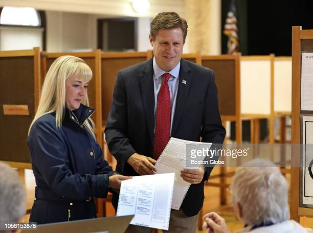 Republican US Senate candidate Geoff Diehl and his wife KathyJo Boss get their ballots at Whitman Town Hall in Whitman MA on Election Day Nov 6 2018