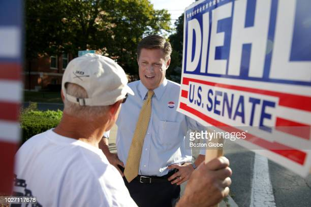 Republican US Senate candidate Geoff Diehl center talks with a supporter after voting in the primary election at the Whitman Town Hall in Whitman MA...
