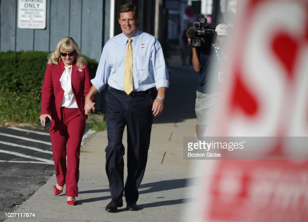 Republican US Senate candidate Geoff Diehl right walks with his wife Kathy Jo Diehl after voting in the primary election at the Whitman Town Hall in...