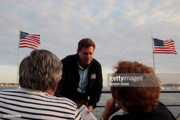Republican US Senate candidate Geoff Diehl shakes hands and talks with Marjie and Pete Lafata of Gloucester during the Concert on Stacy Boulevard in...