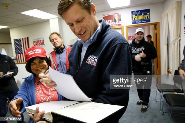 Republican US Senate candidate Geoff Diehl signs a picture for Nom Eaton during a campaign stop in Fitchburg MA on Nov 3 2018