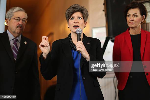 Republican US Senate candidate Joni Ernst flanked by Iowa Gov Terry Branstad and Iowa Lt Gov Kim Reynolds speaks during a campaign stop at the Amtrak...