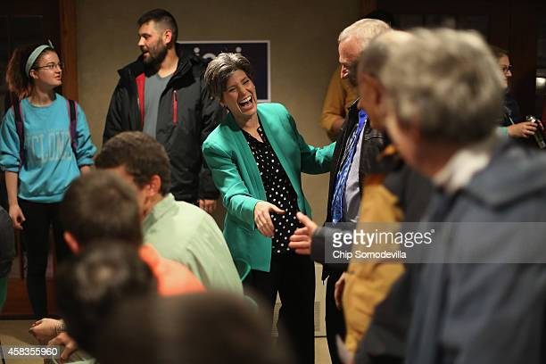 Republican U.S. Senate candidate Joni Ernst greets supporters at the Alpha Gamma Rho fraternity house on the campus of Iowa State University during...
