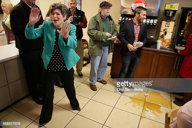 Republican U.S. Senate candidate Joni Ernst reacts to seeing a friend during the kick off of her 'One More Thing' 24-hour campaign push to election...