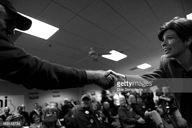 Republican U.S. Senate candidate Joni Ernst shakes hands with a supporter while addressing a crowd at the Johnson County GOP Victory Office during...
