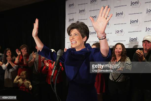 Republican U.S. Senate candidate Joni Ernst takes the stage on election night after being projected as the winner at the Marriott Hotel November 4,...