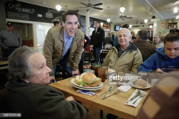 Republican US Senate candidate Josh Hawley greets diners during a campaign stop at Cowan's Restaurant on November 3 2018 in Washington Missouri...