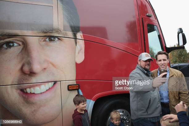 Republican US Senate candidate Josh Hawley greets supporter outside of his campaign bus during a stop at the Jefferson County GOP office to rally...