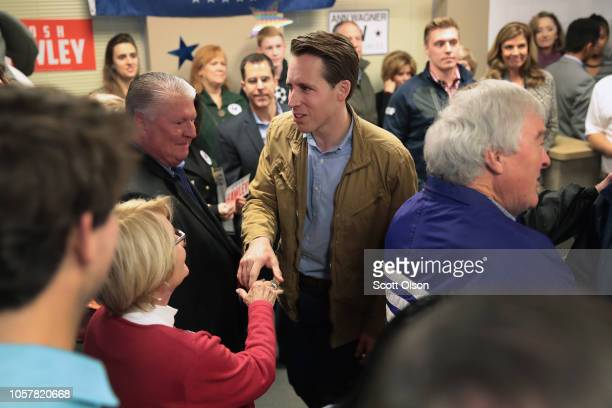 Republican US Senate candidate Josh Hawley greets supporters during a campaign stop at the MOGOP field Office on November 5 2018 in St Louis Missouri...