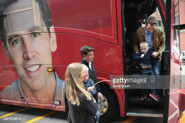 Republican US Senate candidate Josh Hawley helps his son Elijah off the bus during a campaign stop at Cowan's Restaurant on November 3 2018 in...