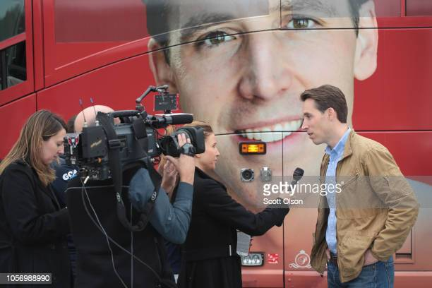Republican US Senate candidate Josh Hawley is interviewed outside of his campaign bus during a stop at the Jefferson County GOP office to rally...