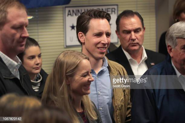 Republican US Senate candidate Josh Hawley listens to speakers during a campaign stop at the MOGOP field Office on November 5 2018 in St Louis...