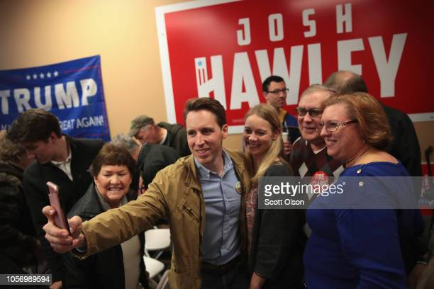 Republican US Senate candidate Josh Hawley with his wife Erin by his side greets supporters during a campaign stop at the Jefferson County GOP office...