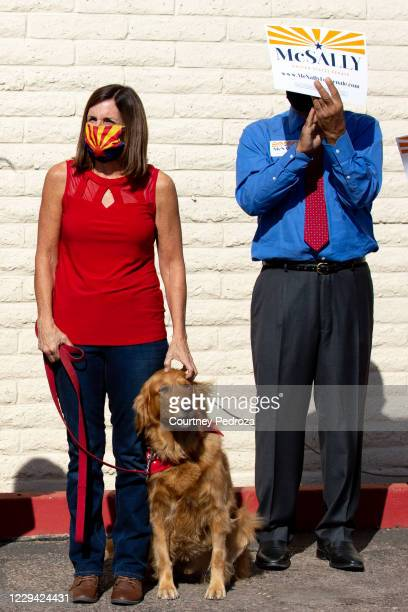 Republican U.S. Senate candidate Sen. Martha McSally pets her dog, Boomer, before speaking to supporters at the AZGOP Headquarters on November 2,...