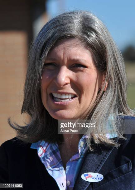 Republican U.S. Senator Joni Ernst films a quick social media post with a staff member after casting her vote on November 2, 2020 in Red Oak, Iowa....