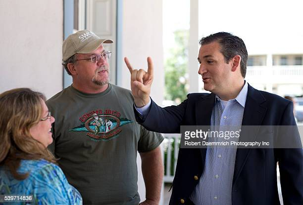 Republican US Senator Ted Cruz flashes a Hookem 'Horns sign as he visits some of his constituents in the historical central Texas town of...