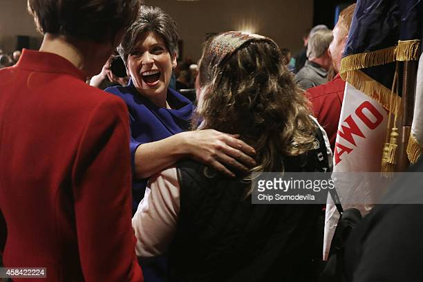 Republican U.S. Senator-elect Joni Ernst embraces and thanks her family after she won the U.S. Senate race on election night at the Marriott Hotel...
