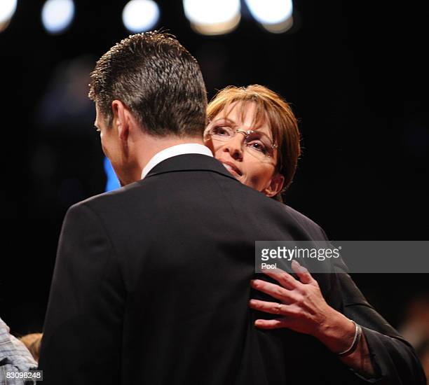 Republican vice presidential candidate Alaska Gov Sarah Palin embraces her husband Todd after the vice presidential debate with Democratic vice...