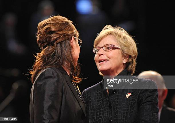 Republican vice presidential candidate Alaska Gov Sarah Palin talks with her mother Sally Heath after the vice presidential debate with Democratic...