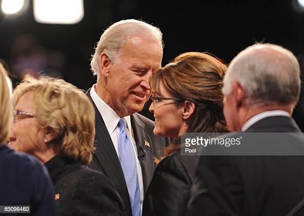 Republican vice presidential candidate Alaska Gov Sarah Palin talks with Democratic vice presidential candidate US Senator Joe Biden after the vice...