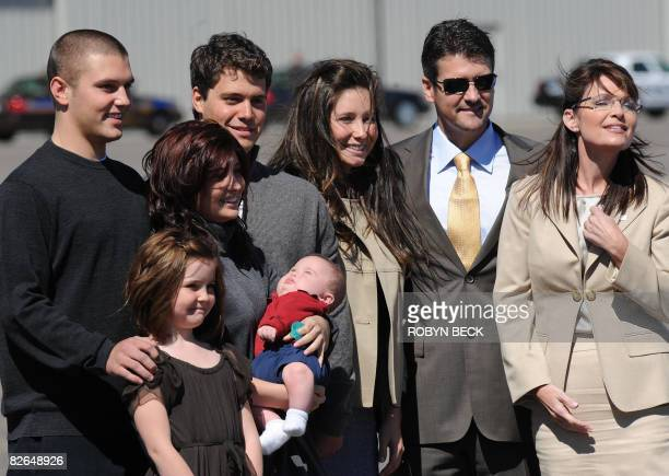 Republican vice presidential candidate Alaska Governor Sarah Palin stands with her family at the airport in Minneapolis Minnesota on September 3 2008...