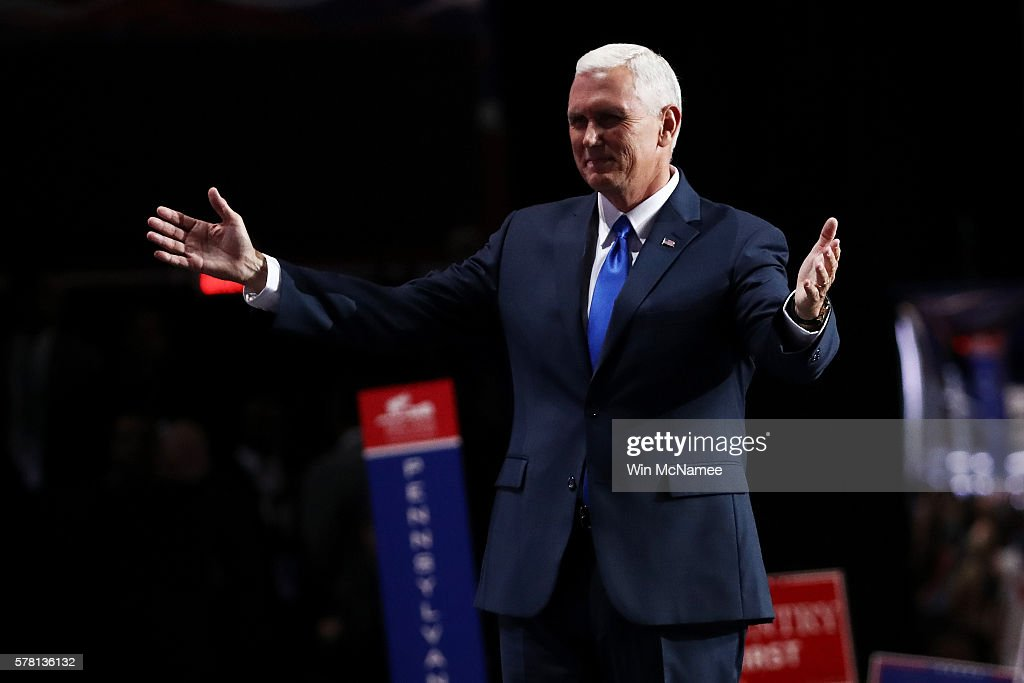 Republican vice presidential candidate Mike Pence acknowledges Republican presidential candidate Donald Trump after delivering his speech on the third day of the Republican National Convention on July 20, 2016 at the Quicken Loans Arena in Cleveland, Ohio. Republican presidential candidate Donald Trump received the number of votes needed to secure the party's nomination. An estimated 50,000 people are expected in Cleveland, including hundreds of protesters and members of the media. The four-day Republican National Convention kicked off on July 18.