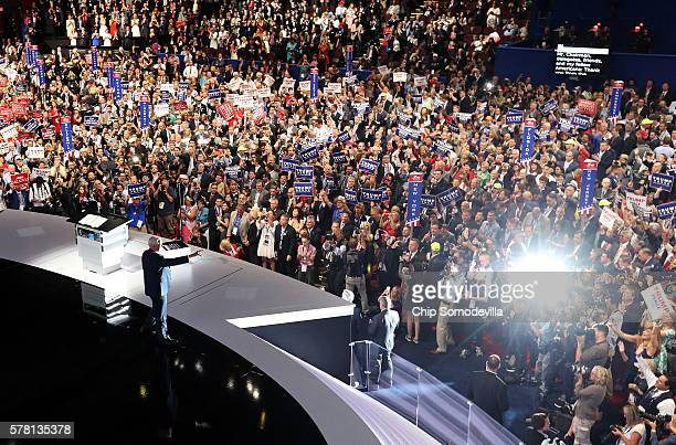 Republican Vice Presidential candidate Mike Pence acknowledges the crowd as he walks on stage to deliver a speech on the third day of the Republican...