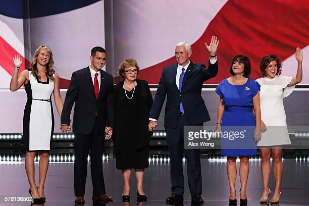 Republican vice presidential candidate Mike Pence acknowledges the crowd along with by Sarah Whiteside Michael Pence mother Nancy Pence wife Karen...